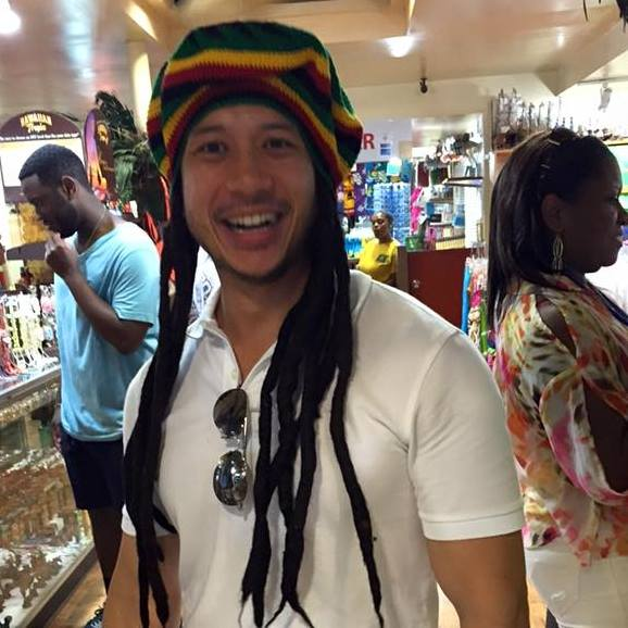 a young man in dreadlocks
